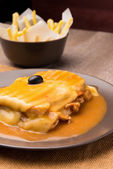 Francesinha and french fries — Stock Photo