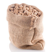 Uncooked chickpeas on burlap bag — Stock Photo