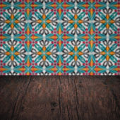 Wood table top and blur  ceramic tile pattern — Stock Photo