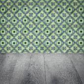 Wood table top and blur vintage ceramic tile pattern wall — ストック写真
