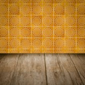 Wood table top and blur   ceramic tile pattern wall — Stock Photo