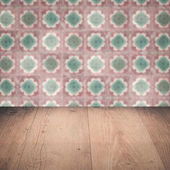 Wood table top and blur vintage ceramic tile pattern wall — Stok fotoğraf