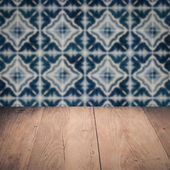 Wood table top and blur vintage ceramic tile pattern wall — 图库照片