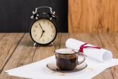 Old clock, hat, coffee and paper sheets — Stock Photo