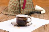 Coffee cup, paper sheets and detective hat — Stock Photo