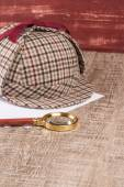 Paper sheets and magnifying glass — Stock Photo