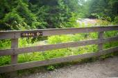 Fence and sign to trail — Stock Photo