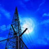 Communications pylon against a blue sky  — ストック写真