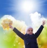 Happy Little Girl with bouquet autumn yellow dry leaves — Stockfoto