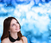 Beautiful Young Woman over snow Christmas background — Stock Photo