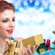 Beautiful Women and eve tree with holidays Gifts over snow blue abstract Christmas background — Stock Photo #60105127