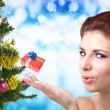 Beautiful Women and eve tree with holidays Gifts over snow blue abstract Christmas background — Stock Photo #60122929