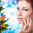 Beautiful Women and eve tree with holidays Gifts over snow blue abstract Christmas background — Stock Photo #60123093