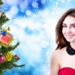 Beautiful Women and eve tree with holidays Gifts over snow blue abstract Christmas background — Stock Photo #60123759
