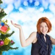 Beautiful Women and eve tree with holidays Gifts over snow blue abstract Christmas background — Stock Photo #60124989