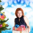 Beautiful Women and eve tree with holidays Gifts over snow blue abstract Christmas background — Stock Photo #60124993