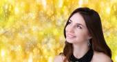 Beautiful portrait young Caucasian Girl over golden abstract Christmas background — Stock Photo