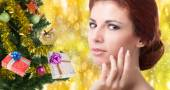 Beautiful portrait young Caucasian Women over golden abstract Christmas background with holidays Tree — Stock Photo
