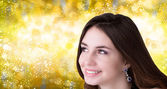 Beauty, people and health concept - beautiful young Women face over blue Christmas background — Stock Photo