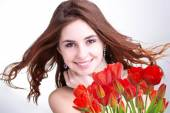 Beauty Woman with Beautiful bouquet fresh red tulips — Stock Photo