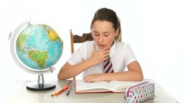 Young schoolgirl in geography class — Stock video