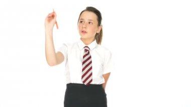 Smiling happy schoolgirl standing writing — Stock Video