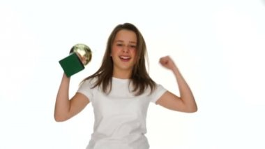 Triumphant jubilant young schoolgirl with a trophy — Stock Video