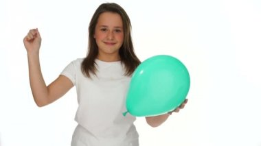 Young girl about to prick a party balloon — Wideo stockowe