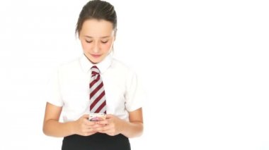 Young schoolgirl sending an sms on her mobile — Stock Video