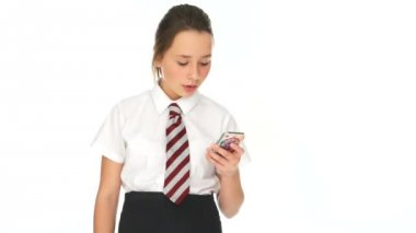 Young schoolgirl listening to a call on her mobile — Stock Video