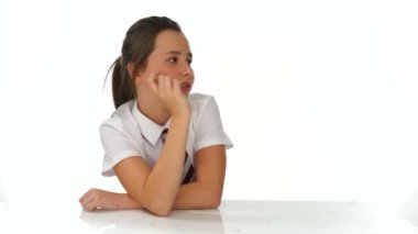 Young girl smiling and pointing to the side — Stock Video