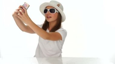 Fashionable cute young girl using a mobile — Stock Video