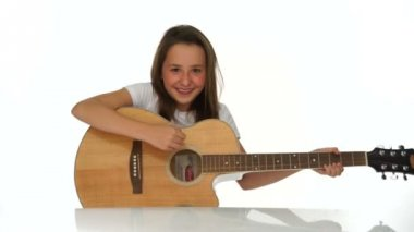 Young girl playing a wooden guitar — Stock Video