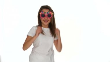 Smiling happy young girl in funky sunglasses — Stock Video