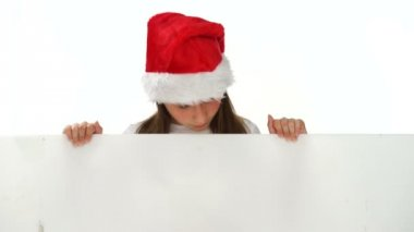 Young girl in a Christmas hat with a blank sign — Stock Video