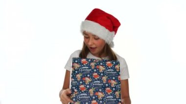 Little girl tearing open a Christmas present — Stock Video
