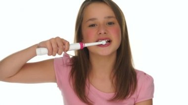 Responsible young girl brushing her teeth — Stock Video