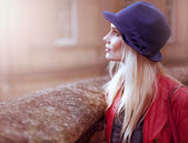 Young woman in a hat standing daydreaming — Stock Photo