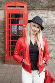 Attractive trendy young woman in a red jacket — Stock Photo