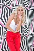 Seductive Young Blond Woman Posing at Printed Wall — Stock Photo