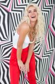 Seductive Young Blond Woman Posing at Printed Wall — Stockfoto