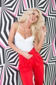 Seductive Young Blond Woman Posing at Printed Wall — Stockfoto