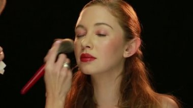 Artist Putting Make-up to Pretty Young Model — Stockvideo