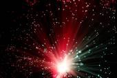 Illuminated Fiber Optic Strands on Black — Stock Photo
