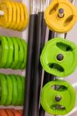 Colorful new weights in a gym or shop — Stock Photo