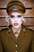 Attractive blond model in army uniform — Stock Photo