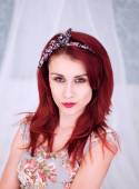 Pretty redhead woman in a floral dress — Stock Photo