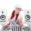 Young Female Mixing Music Using DJ Mixer — Stock Photo #63002877