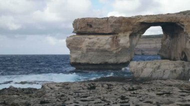 Azure Window, famous stone arch on Gozo Island, Malta. — Stock Video