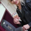 Woman Showing Withdrawn Money from the ATM — Stock Photo #63828335